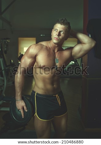 Portrait of a strong handsome guy posing. Bodybuilder - stock photo