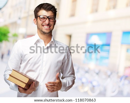 Portrait Of A Student Holding Book, Outdoor