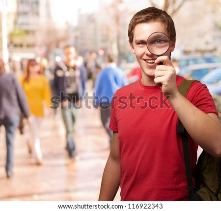 Portrait Of A Student Looking Through Magnifying Glass, Outdoor