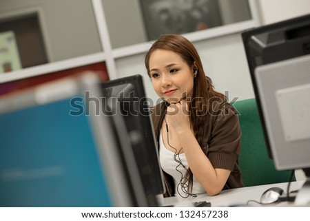 Portrait of a student working in a computer-class - stock photo