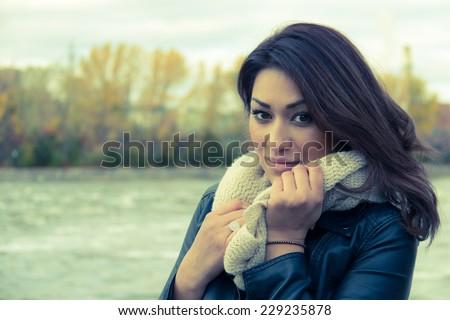Portrait of a stylish Hispanic woman during autumn - stock photo