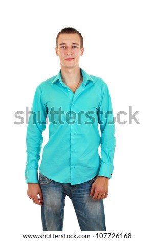 portrait of a stylish young man in cyan shirt and jeans standing over white background - stock photo