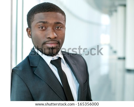 Portrait of a successful African American business man at the office building - stock photo