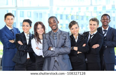Portrait of a successful american african businessman smiling leading his team - stock photo