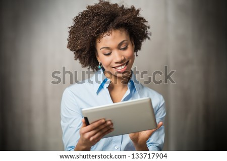 Portrait of a Successful Business woman Using Digital Tablet - stock photo