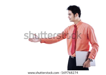 Portrait of a successful businessman giving a hand for handshaking with someone - stock photo
