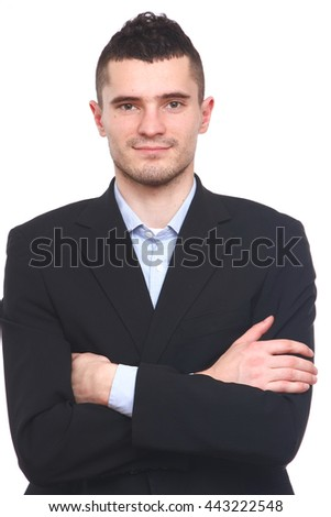 Portrait of a successful businessman standing with crossed hands, isolated on white background - stock photo