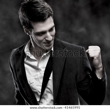 Portrait of a successful businessman with bag, studio shot - stock photo