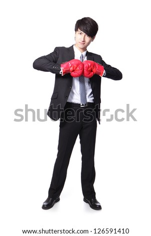 Portrait of a successful businessman with boxing gloves in full length isolated over white background, asian model - stock photo