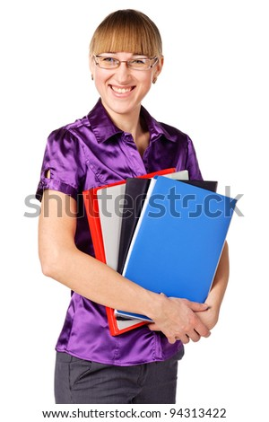 Portrait of a successful businesswoman holding a folders, looking at camera and smiling