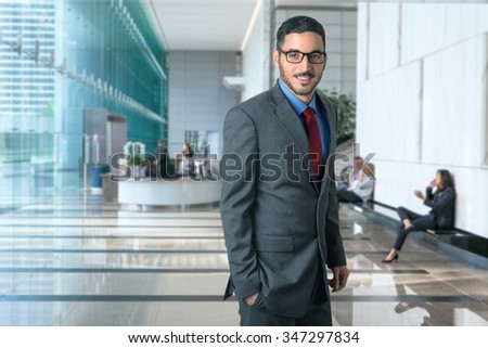 Portrait of a successful corporate business man executive in a modern office workplace environment confident stylish CEO - stock photo