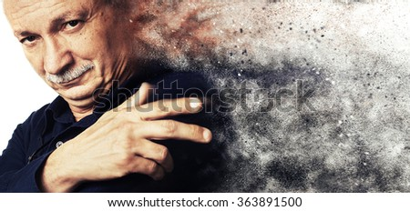 Portrait of a successful elderly with a dust explosion.  High-contrast image with intentional color shift