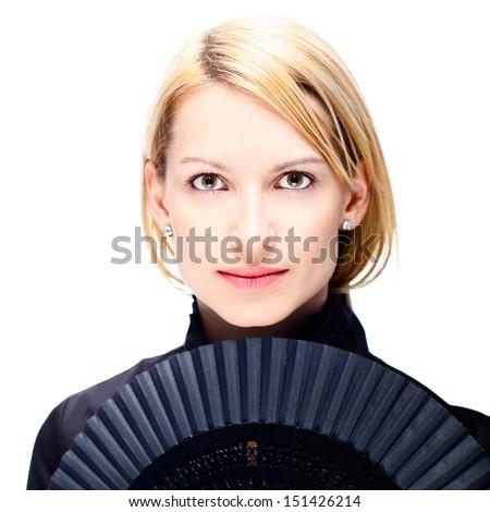 Portrait of a successful,  elegant, attractive, business woman wearing black blouse holding folding fan. - stock photo