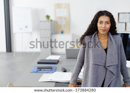 portrait of a successful female entrepreneur standing in the office, with copy-space - stock photo