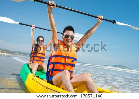 Portrait of a successful rowing team in kayak - stock photo