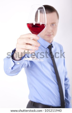 Portrait of a successful young business man holding glass of wine. - stock photo