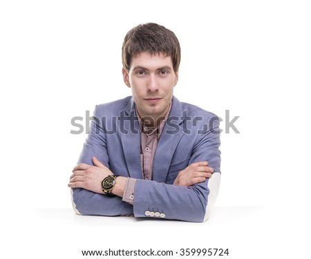 Portrait of a successful young businessman in blue suit. - stock photo