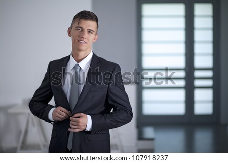 Portrait of a successful young Businessman posing in office