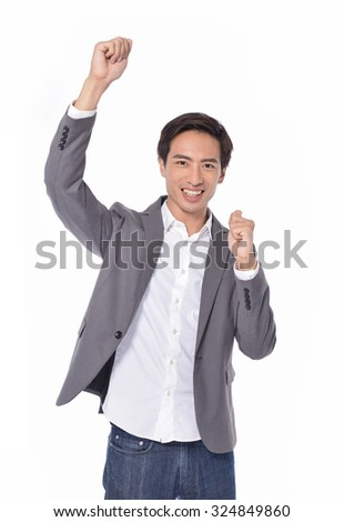 Portrait of a successful young businessman with his hands raised