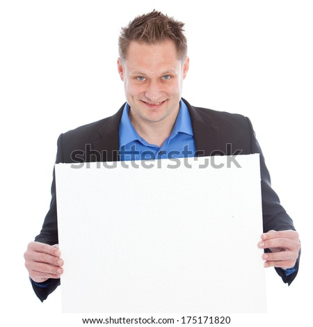 Portrait of a successful young Caucasian man with blue eyes and shirt smiling and looking at camera while holding a blank whiteboard, isolated on white background - stock photo
