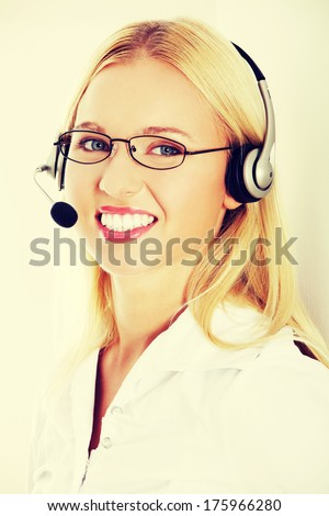 Portrait of a successful young female call centre employee wearing a headset