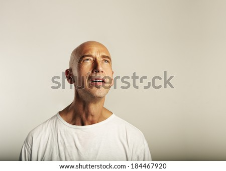Portrait of a suffering man - stock photo