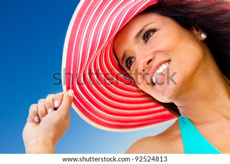 Portrait of a summer girl wearing a hat - stock photo