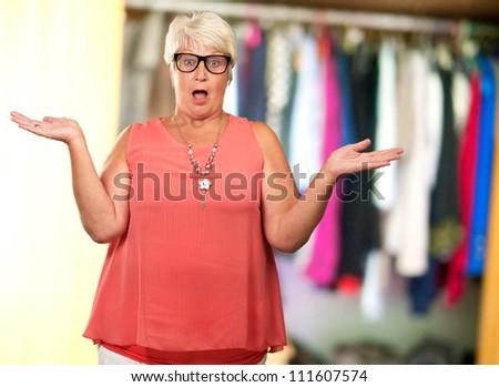 Portrait Of A Surprise Mature Woman, Indoor - stock photo