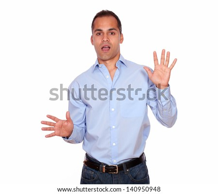 Portrait of a surprised adult man looking at you against white background