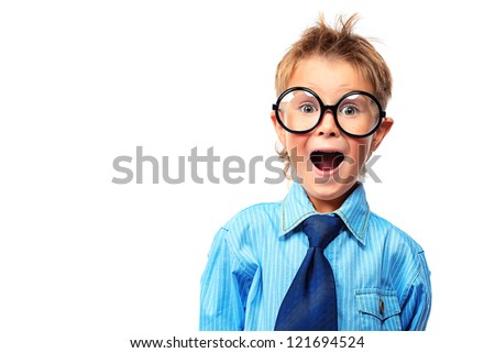 Portrait of a surprised little boy in spectacles and suit. Isolated over white background. - stock photo