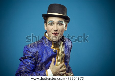 Portrait of a surprised man on a blue background - stock photo