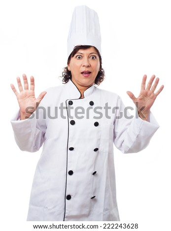 portrait of a surprised mature woman wearing like a chef on a white background - stock photo