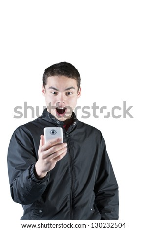 Portrait of a surprised teen reading text message on cellphone over white background - stock photo