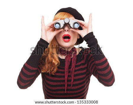 portrait of a surprised young lady using her binoculars isolated on white background - stock photo