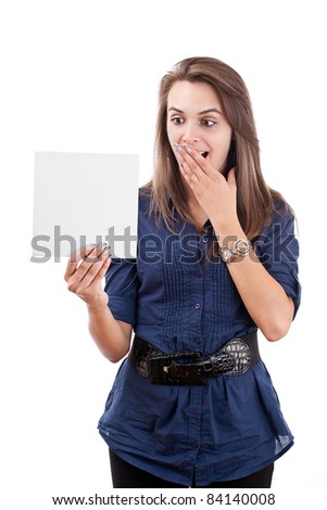 Portrait of a surprised young woman looking at a blank card isolated over white background - stock photo