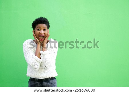 Portrait of a surprised young woman with hands on face  - stock photo