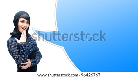 Portrait of a surprised young woman with hands over her mouth laughing against white background. Blank balloon for your text and logo