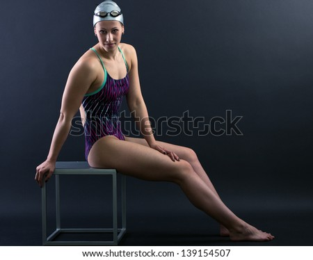 Portrait of a swimmer on a dark background.