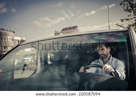 Portrait of a taxi driver - stock photo