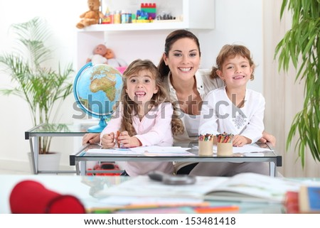 Portrait of a teacher with her pupils - stock photo