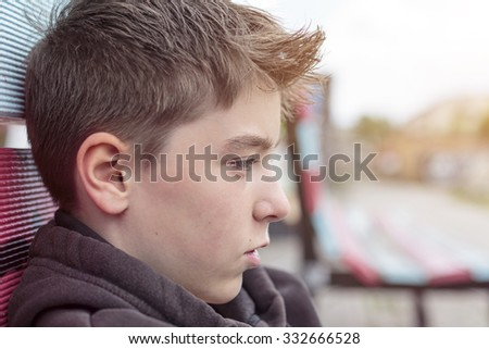 portrait of a teenage boy in profile