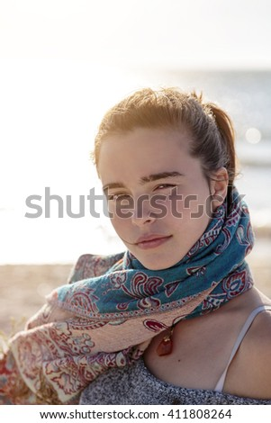 portrait of a teenage girl at the beach