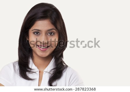 Portrait of a teenage girl over white background