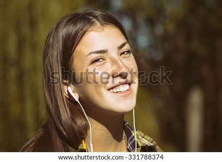 Portrait of a teenage girl with headphones