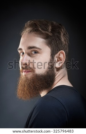 Portrait of a Teenage Hipster with Beard