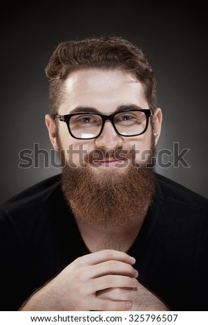 Portrait of a Teenage Hipster with Beard and Glasses
