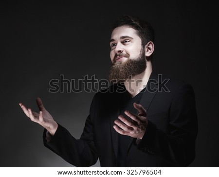 Portrait of a Teenage Hipster with Beard Gesticulating - stock photo