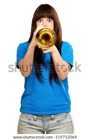 portrait of a teenager playing trumpet on white background - stock photo