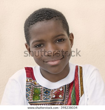 Portrait of a ten-year-old Afro boy smiling  - stock photo