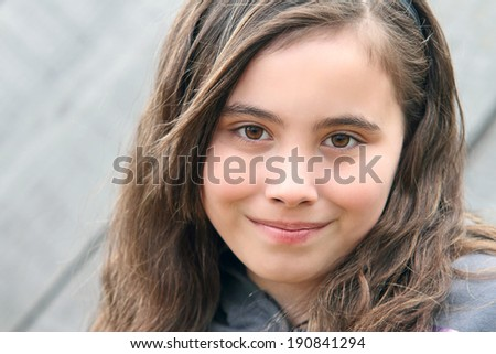 Portrait of a ten year old child with brown hair. - stock photo